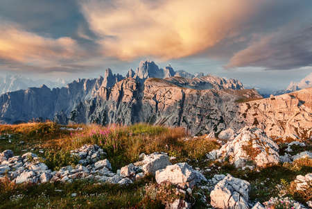 Awesome alpine highlands in sunny day. Scenic image of fairy-tale Landscape with colorful sky under sunlit, over the Dolomites Rock Mountains. Wild area. Megical Natural Background. Creative image. 版權商用圖片