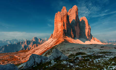 Great sunny view of the National Park Tre Cime di Lavaredo, Panoramic view of three spectacular mountain peaks. Awecome nature landscape. Amazing mountain valley under sunlight. Dolomites Alps