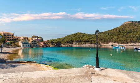 Wonderful summer seascape. Assos village in Kefalonia, Greece. Mediterranean architecture and turquoise Ionian sea 版權商用圖片