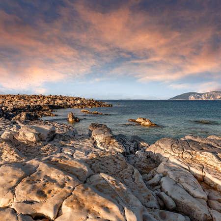Vibrant sunset against a sunny sky over Ionian sea. Fantastic seascape with colorful sky.
