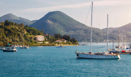 Beautiful seascape bay with luxury yachts at the coast of Mediterranean Sea, Ionian Island. Greece