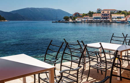 Wonderful summer seascape of Ionian Sea. Wonderful place for holiday. Amazing Greece. Picturesque colorful village Assos in Kefalonia. Turquoise colored bay in Mediterranean sea. Amazing postcard