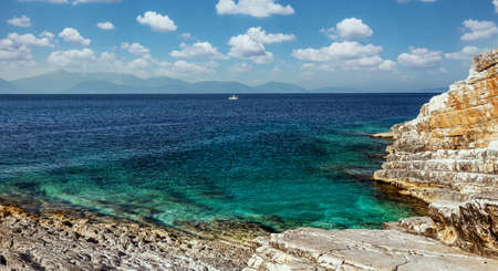 Picturesque Greece landscape. Amazing cliff rocks on the west coast of Ionian sea. Wonderful summer seascape with perfect blue sky