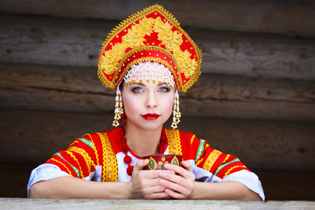 Russian girl drinking tea in the village photo