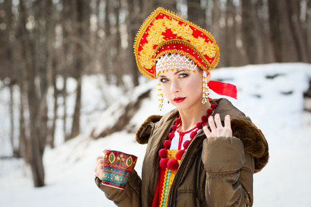 Russian girl drinking tea photo