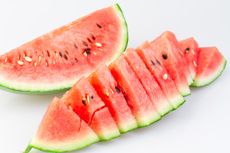 Closeup of sliced watermelon on white background