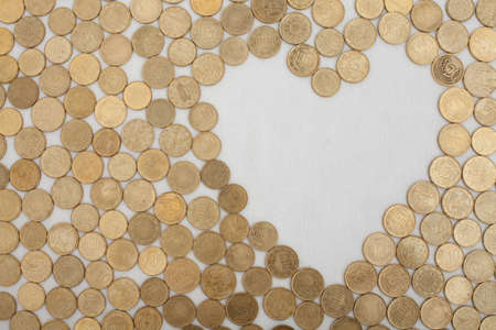 coinage: a set of eurocentcoins leaving a heart shaped field empty