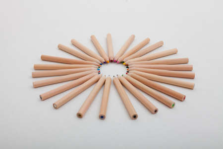 a set of colored pencils arranged in a circle Stock Photo