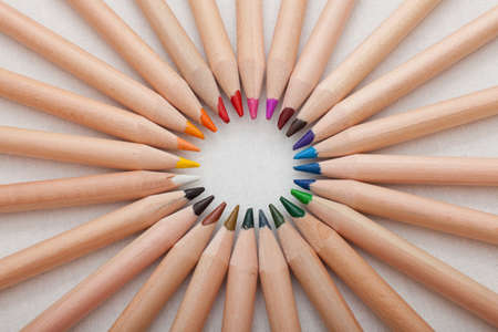 a closeup of a set of colored pencils arranged in a circle