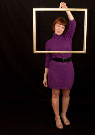 a young adult woman holding a frame