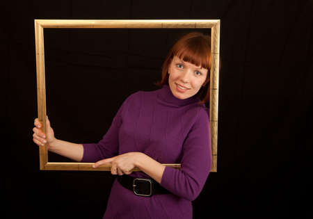 a young adult womand leaning in a picture frame photo