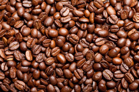 roasted coffee beans forming a background pattern Stock Photo