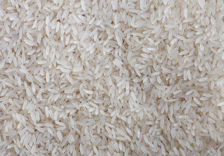 some raw rice forming a background pattern Stock Photo - 8788914