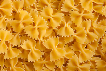 some farfalle pasta forming a background pattern Stock Photo - 8788915