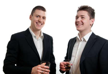 two young businessmen drinking whisky Stock Photo