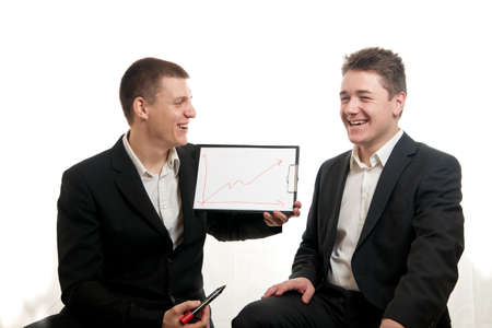a young businessman presenting a chart while other smiles
