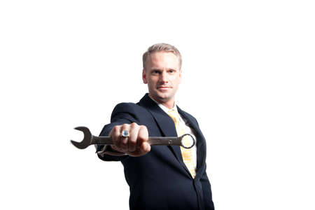 a closeup of a young businessman holding a wrench to the camera Stock Photo