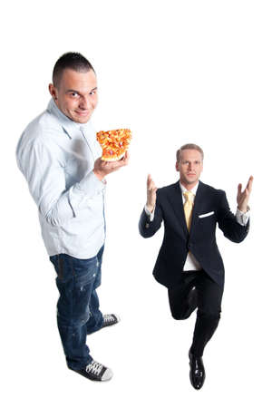 happy man eating pizza next to a frustrated businessman photo