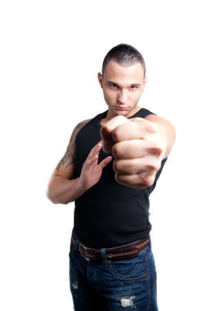 a young man pointing with his fist to the viewer