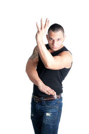 wing figure: a casual dressed young man posing in a wing tsun stance