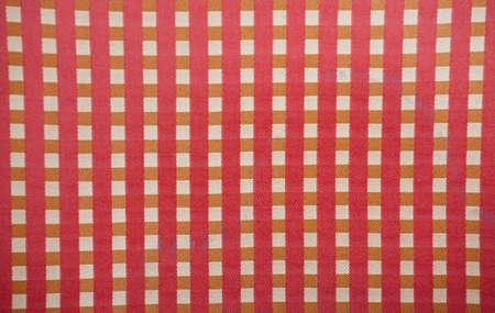 a background pattern consisting of checkered fabric Stock Photo