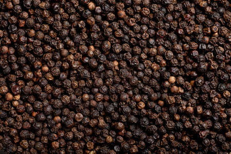 some black pepper seeds forming a background pattern