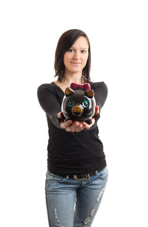 a young woman presenting a piggy bank to the camera