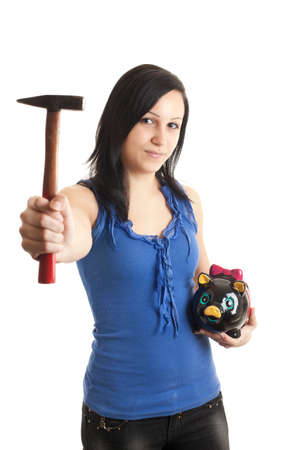 coinbank: a young woman holding a piggy bank and a hammer isolated on white