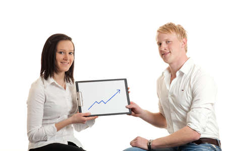 two young businesspeople presenting a cliboard with a chart indicating  growth photo