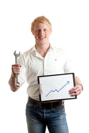 a young businessman holding a chart indicating growth and a wrench
