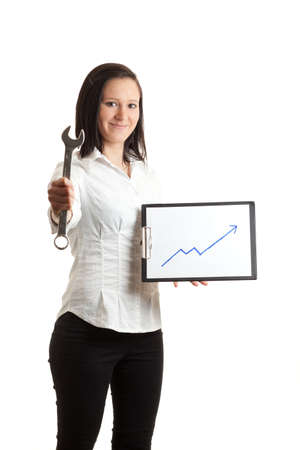 a young woman holding a chart indicatin growth and a wrench
