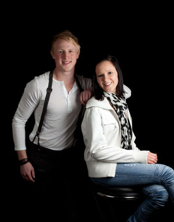 a young man leaning on a young woman posing Stock Photo