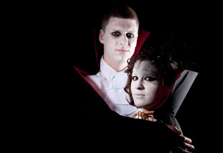 a young vampire couple posing together black background Stock Photo