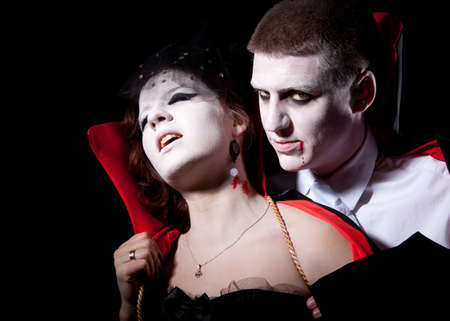a vampire biting a young woman from behind