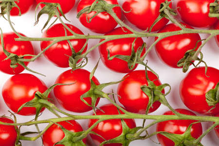 some cherry tomatoes forming a background pattern Stock Photo - 9312740