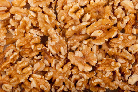 some walnut seeds forming a background pattern Stock Photo - 9312737
