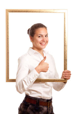 a young businesswoman holding looking through a pictureframe showing thumb up Stock Photo