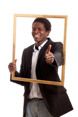 a dark skinned businessman holding a frame showing thumb up photo