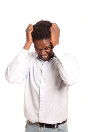 a dark skinned man posing frustrated with hand in the hair