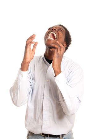 a dark skinned man shouting while beeing very frustrated Stock Photo