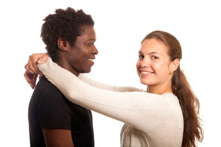 a multiracial couple posing together holding each other Stock Photo