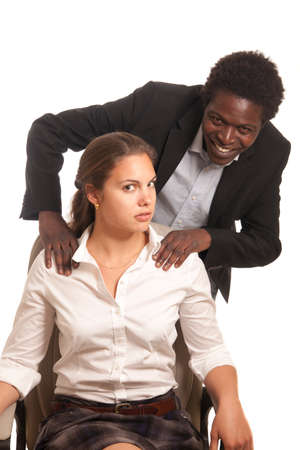 uncomfortable: young woman beeing  touched by a fellow coworker