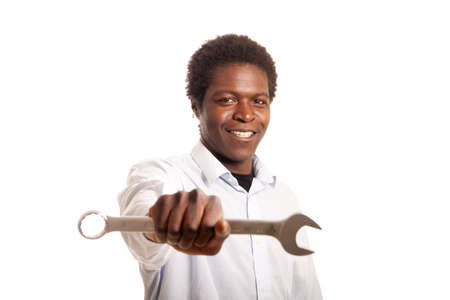 a young black man showing a wrench