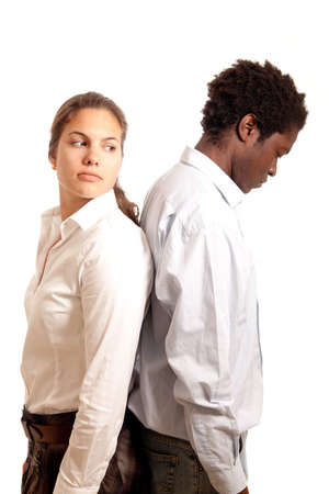 a young couple looking sad standing with their back to each other Stock Photo