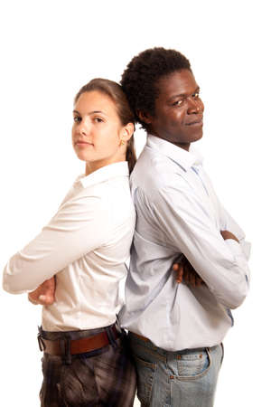 a young team or couple standing with their back to each other looking confident Stock Photo - 9357182