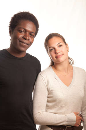 a multiracial couple posing together for the camera