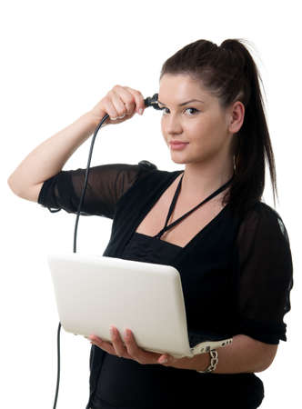 a young adult woman holding a notebook and putting a power cable to hear head