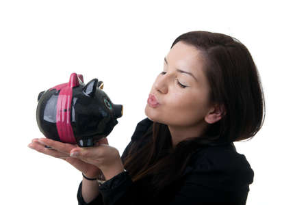 a young adult woman kissing a coinbank with closed eyes Stock Photo
