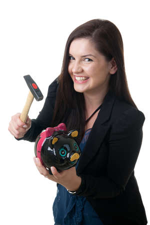 coinbank: a young adult woman holding a pig bank and a hammer smiling