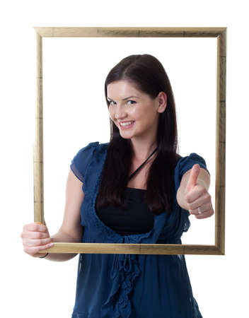 a young woman looking through a picture frame showing thumb up